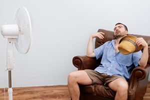 man-on-couch-with-fan