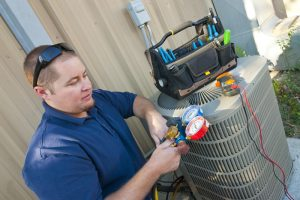 ac-technician-inspects-ac-unit
